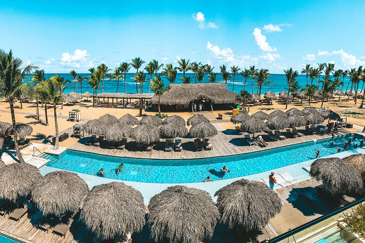Wide view of the Excellence El Carmen resort and its pool area.