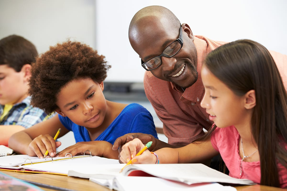 Teacher Giving an Education to Students