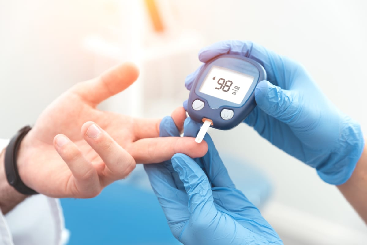 Doctor checking blood sugar level