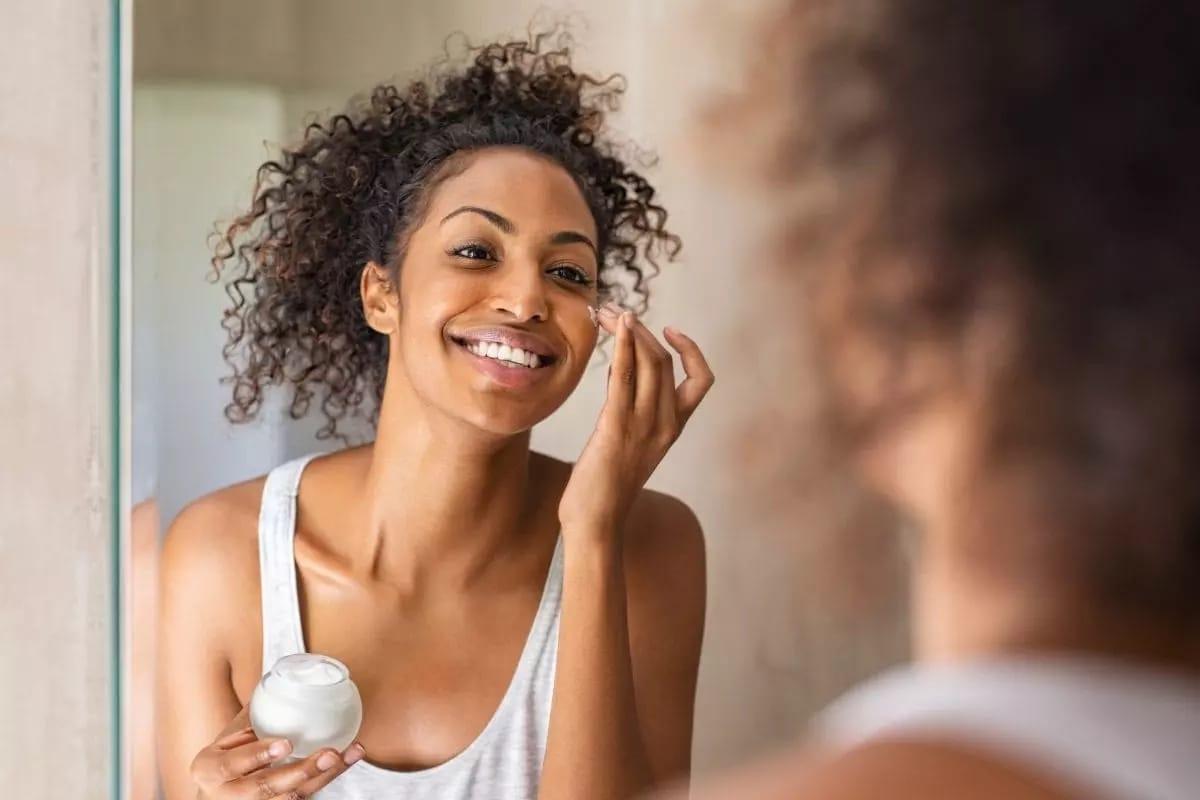 Women using moisturizer