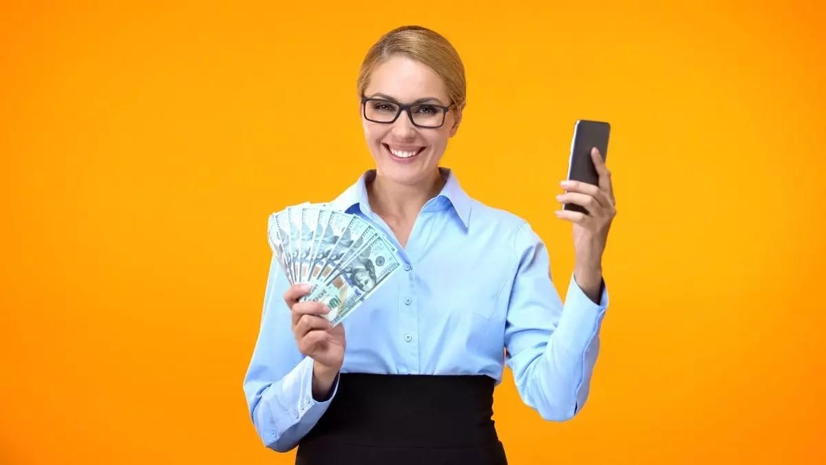Woman Holding Smartphone and Money
