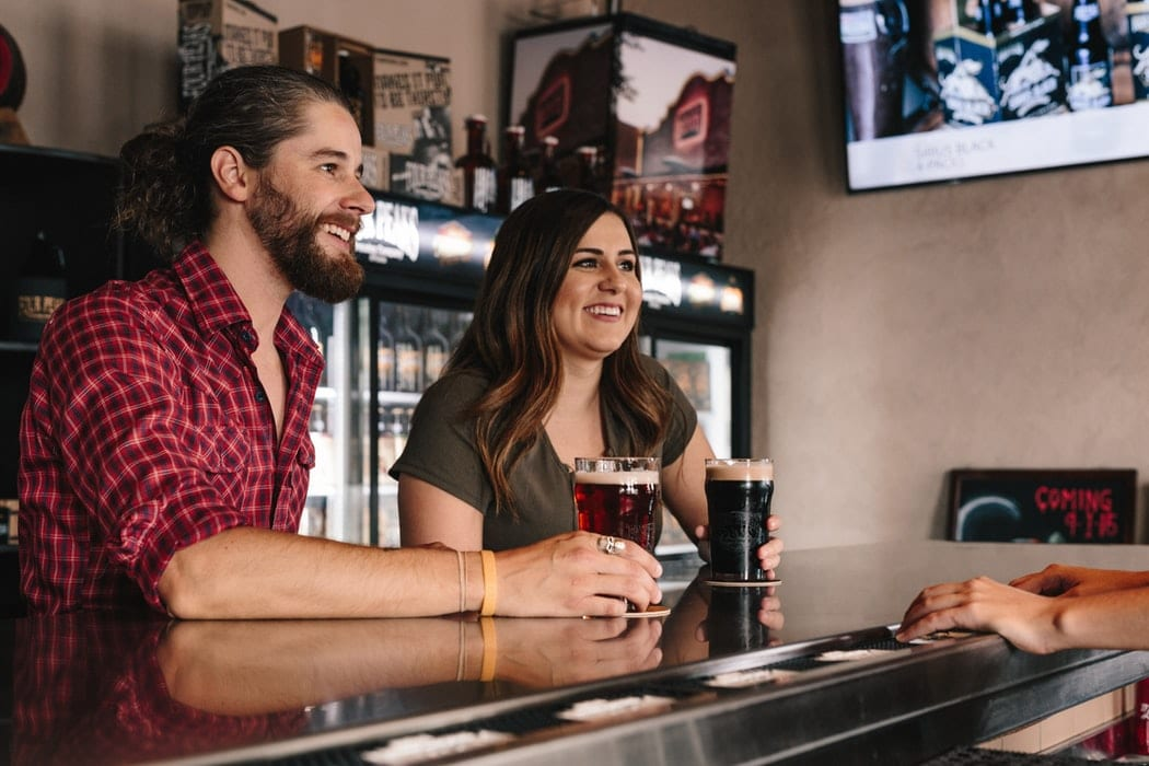 Couple at a Bar Talking to the Bartender