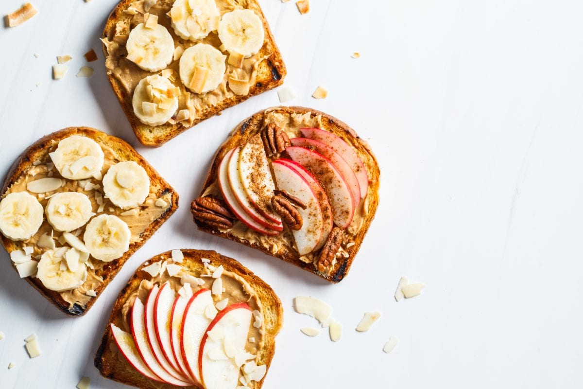 Sliced Fruits with Nut Butter on Toast