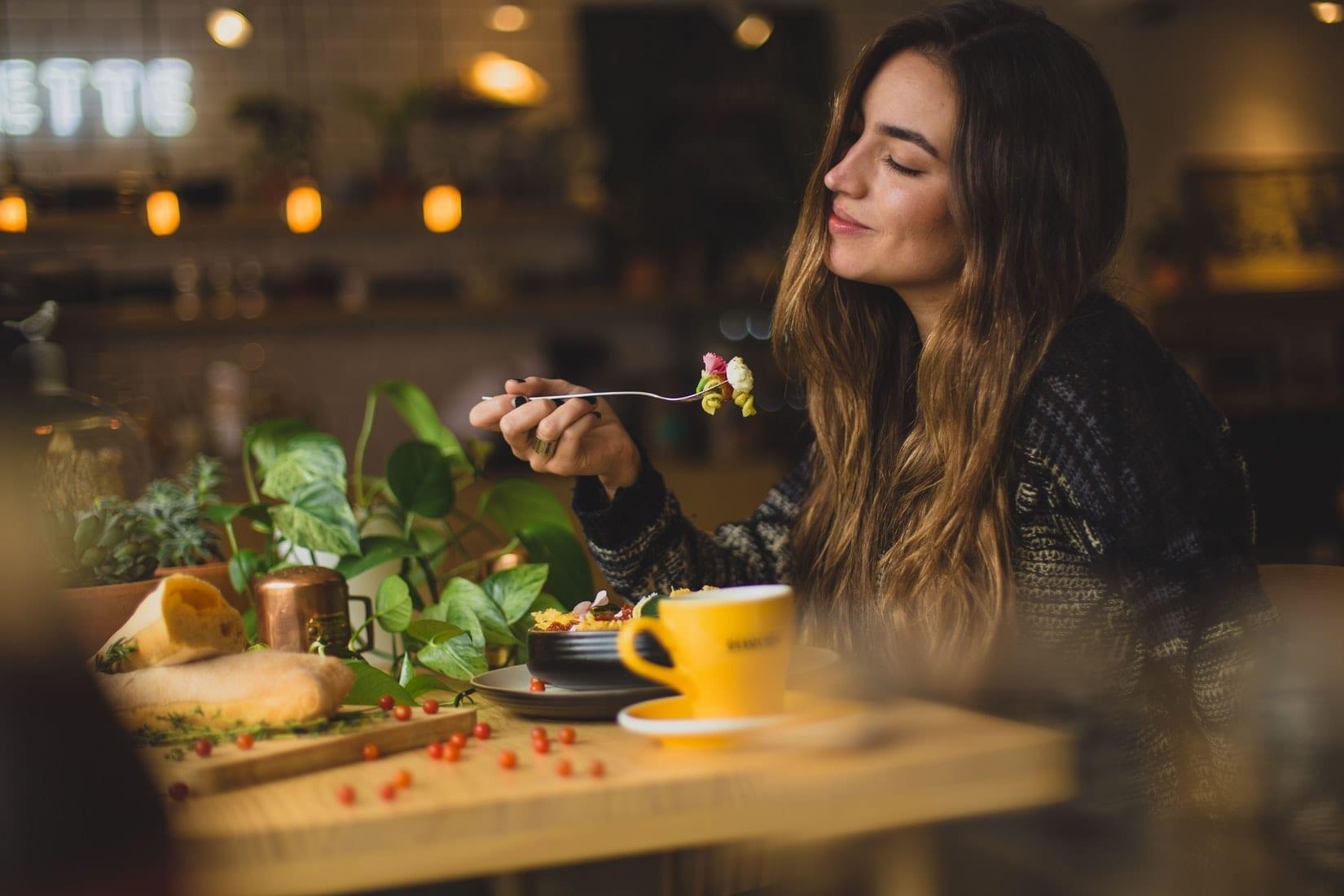 Woman-Enjoying-her-Pasta-Salad