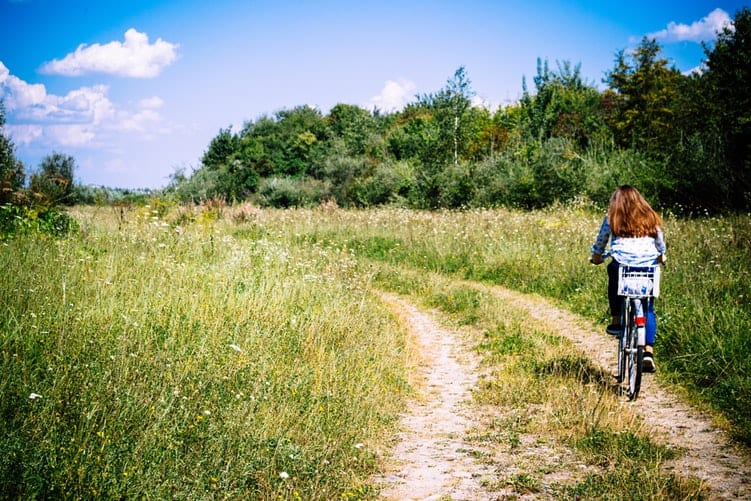 Young Woman Riding her Bike in Nature