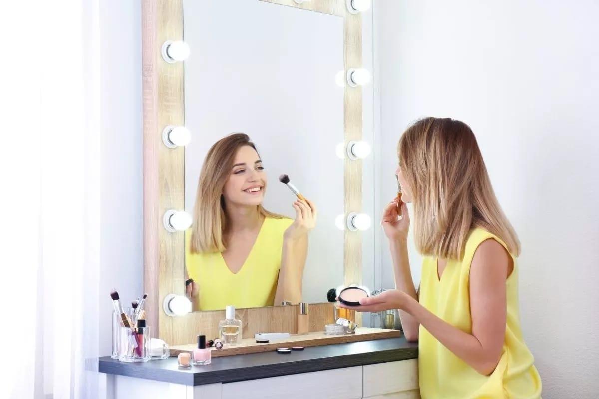 Girl-applying-mkaeup-at-makeup-vanity