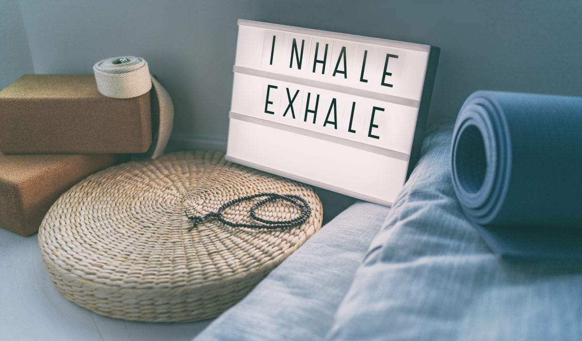 Inhale and Exhale Sign Next to Yoga Mat