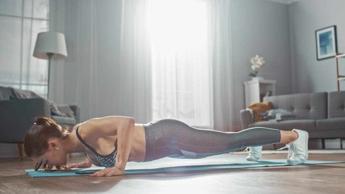 Fit Women Doing Push Ups at Home
