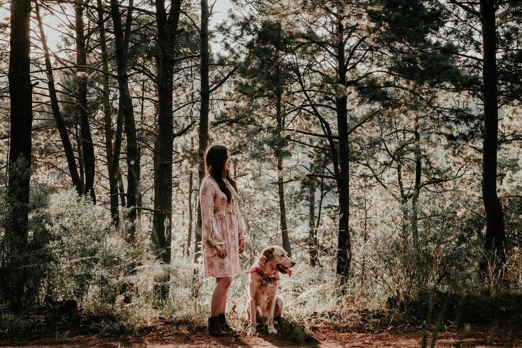 Girl Walking her Dog in Nature