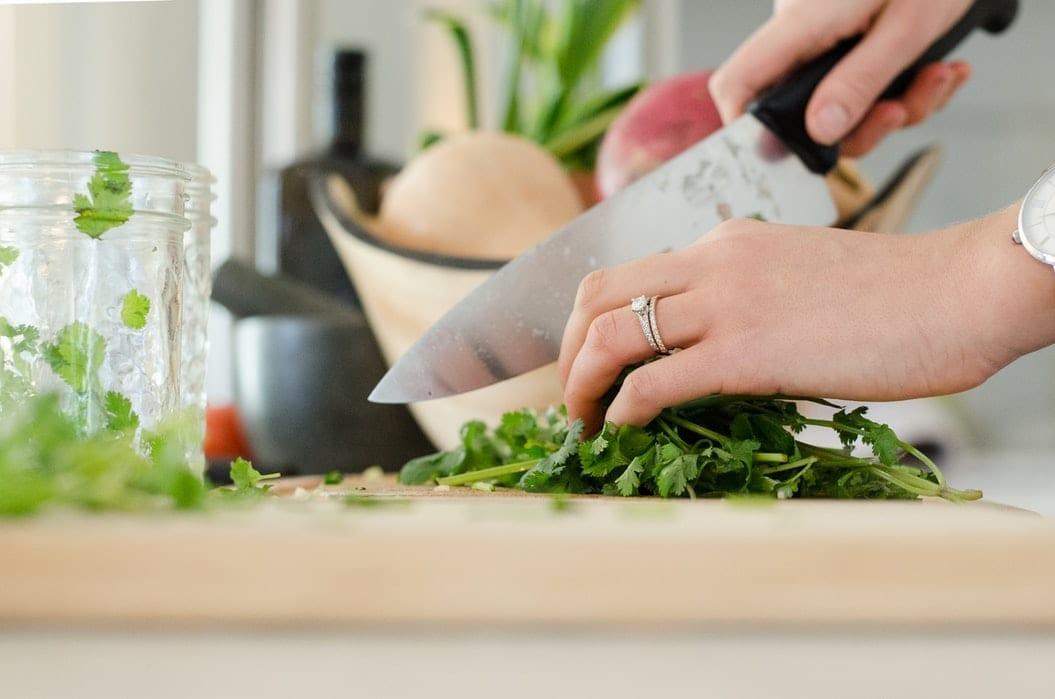 Woman Chopping Cilantro at Home