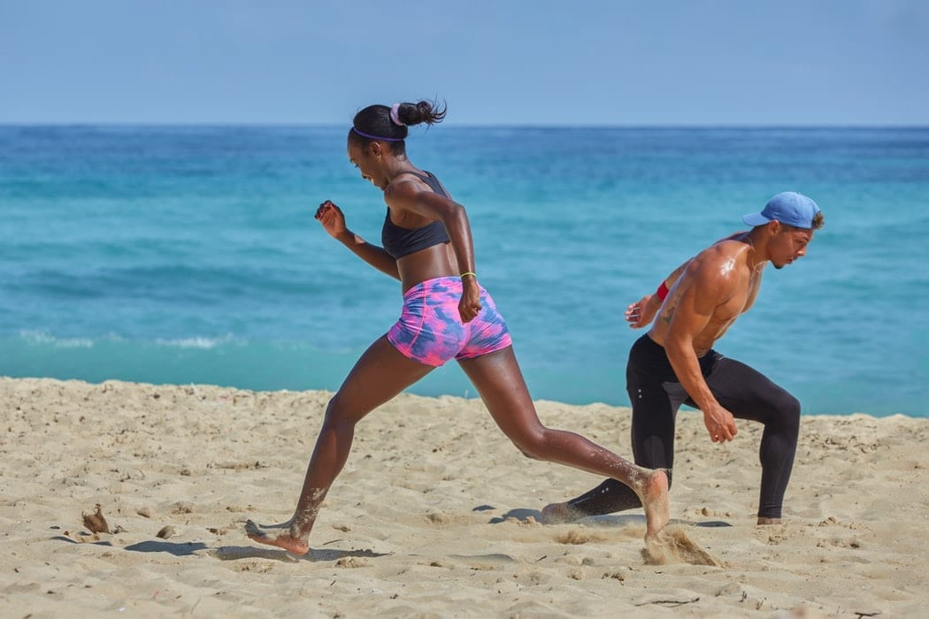 Man and woman training at the beach