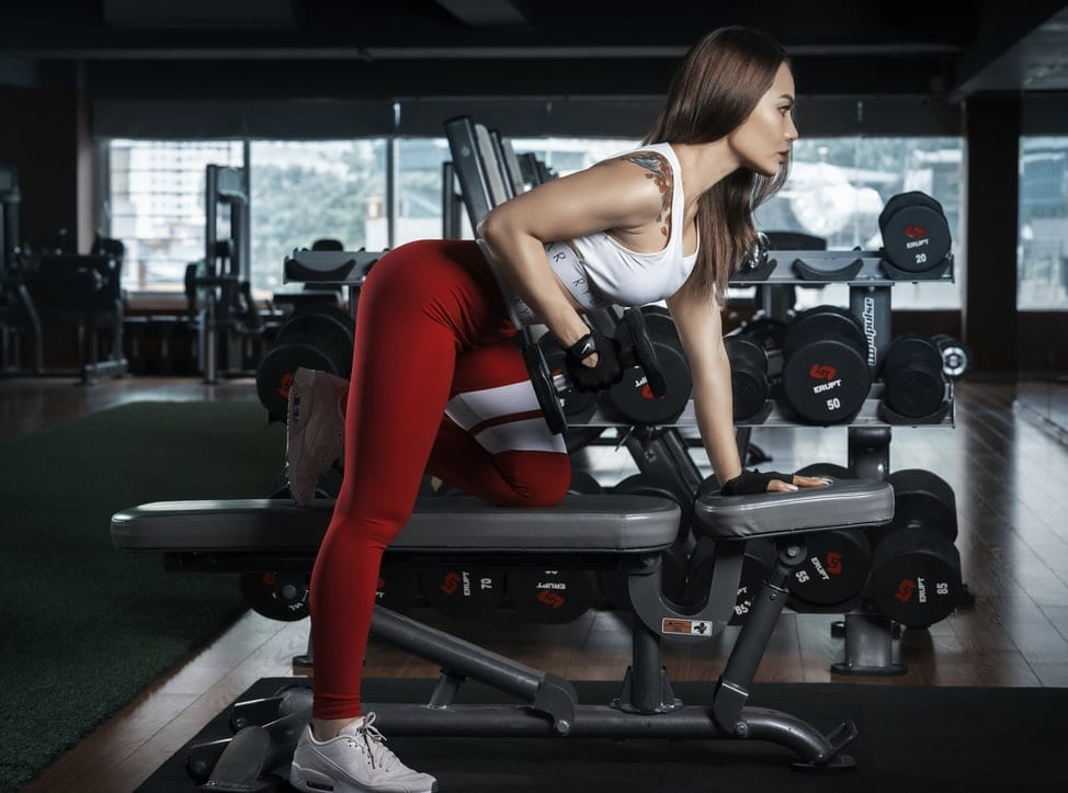 Woman working out wearing red leggings
