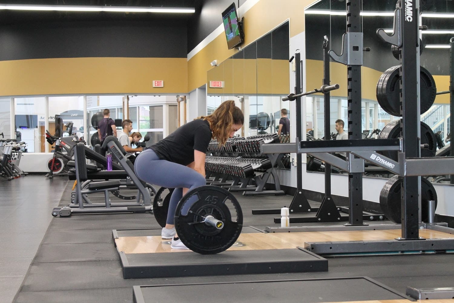 woman weightlifiting at the gym