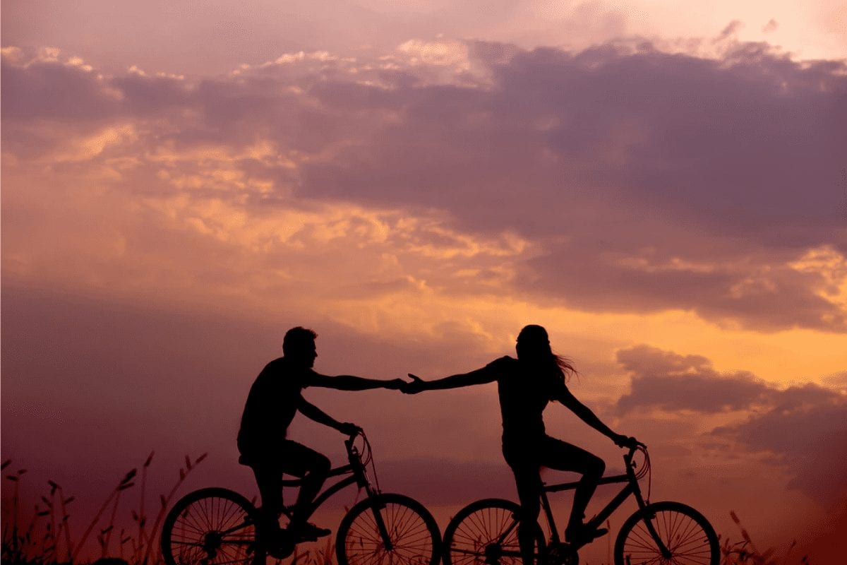 Couple Riding Bicycle in Sunset