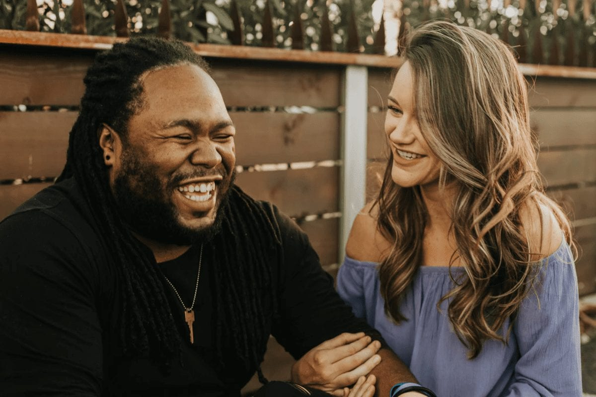 Interracial Couple Smiling Together